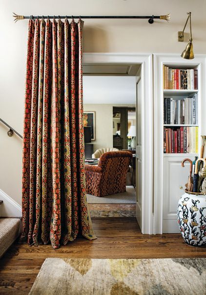 traditional entry by Random House - hang portiere (floor length drapes) at bottom of stairs in winter