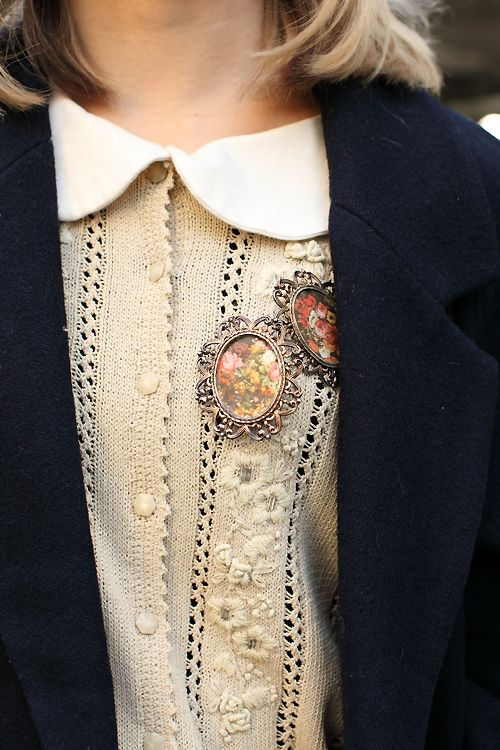 vintage cream cardigan, peter pan collar and brooches.