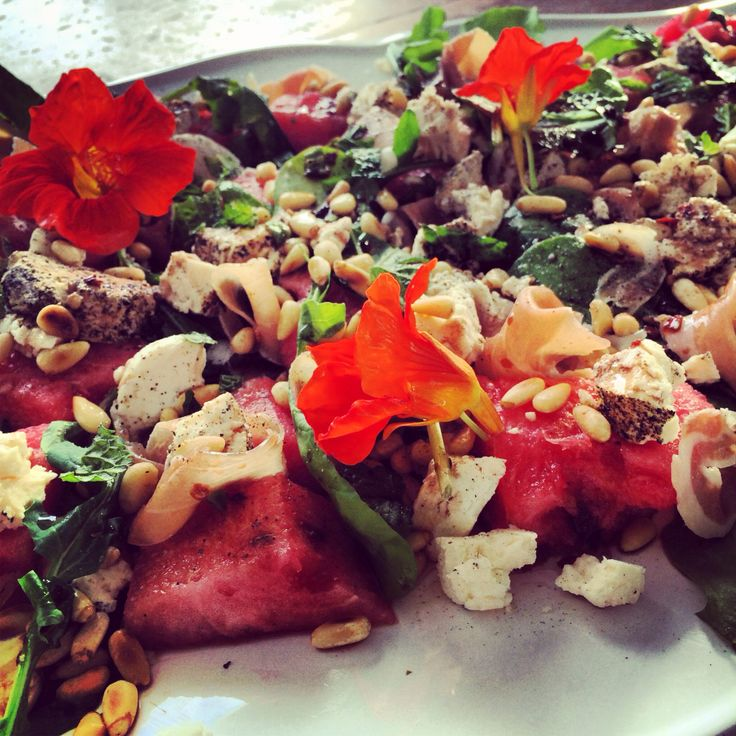 Watermelon, Parma Ham and Goats cheese salad with rocket & pine nuts and a drizzle of lemon, mint and chili vinaigrette.