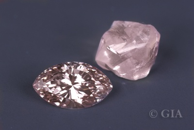 Pink marquise shaped diamond with rough pink diamond crystal. GIA. 9/27/12.