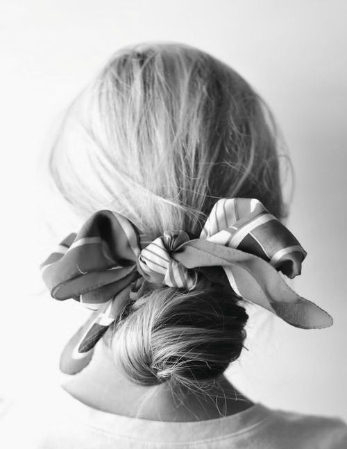 Tie a scarf in your hair. Love this simple & chic hairstyle