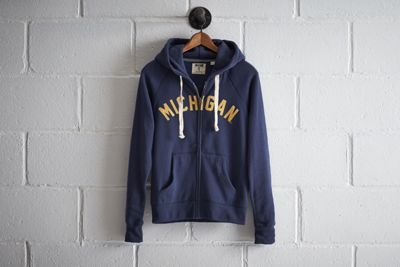 Tailgate Women's Michigan Zip Hoodie by  American Eagle Outfitters | At a capacity of over 100k, the Wolverines play in the largest football stadium in the nation. Plus, they boast the most overall wins in NCAA history and won the very first Rose Bowl.At a capacity of over 100k, the Wolverines play in the largest football stadium in the nation. Plus, they boast the most overall wins in NCAA history and won the very first Rose Bowl. Shop the Tailgate Women's Michigan Zip Hoodie and check out…