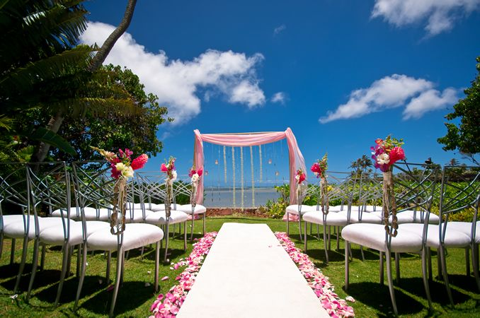 Hawaiian wedding theme...I'd prefer sage green tulle with orchids tied in them versus pink.