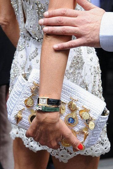 Sequins & religious pins on a crochet bag by Dolce & Gabbana