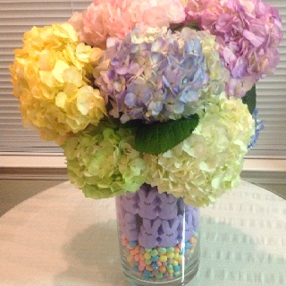 Easter centerpiece.  Coat the bottom of a vase with jelly beans, then put another cylinder in the center, add more jelly beans, then a couple of rows of bunny peeps, and some hydrangeas in the inner cylinder.  This can also be modified and work for a baby shower.