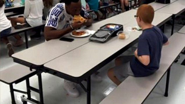FSU football player Travis Rudolph eats lunch with Bo Paske who is autistic.