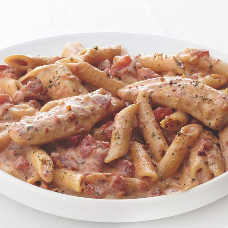 Pasta dinners are an easy crowd-pleaser. Tomatoes, parmesan and chicken make this one a stand-out.