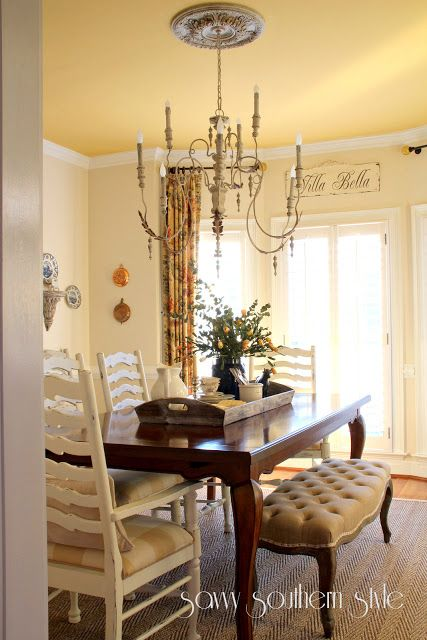 Savvy Southern Style: Dining Room  love the tufted bench  and painted chairs with dark table