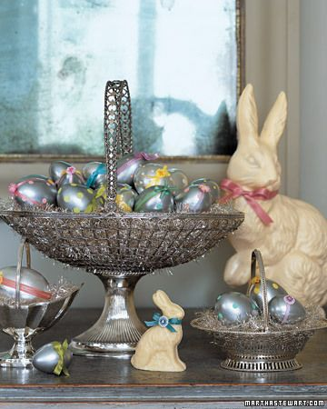 "Metallic Polka-Dotted Eggs  This dramatic scene sets a new silver standard for Easter. There are whimsically polka-dotted and beribboned silver blown-out eggs, filigreed sterling silver ""baskets,"" and, of course, dapper chocolate bunnies -- here, white chocolate, tied with ribbons to match the dots.  Metallic Polka-Dotted Eggs How-To"