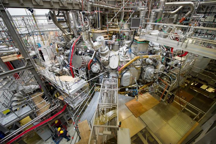 """FILE - This Dec. 10, 2015 file photo shows the nuclear fusion research center at the Max Planck Institute for Plasma Physics where the first plasma has been produced at the """"Wendelstein 7-X"""" in Greifswald, Germany. Scientists are poised to flip the switch on an experiment that could take them a step closer to the goal of generating clean and cheap nuclear power. Researchers at the institute plan to inject hydrogen into a doughnut-shaped device to produce a super-hot gas known as pl..."""