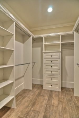 I love this closet! It's clean and bright looking, I love the light colored wood floor, and how there is not a lot of wasted floor space!