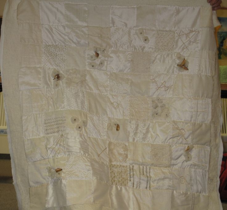 Debbey's white silk hand embroidered quilt