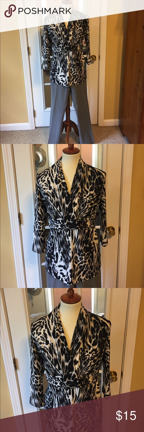 New York and company animal print blouse. New York and company animal print blouse. This is a beautiful blouse with a gorgeous neck line. 3/4 sleeve, cinched waist with built in wide belt look (see photo's) New York & Company Tops Blouses