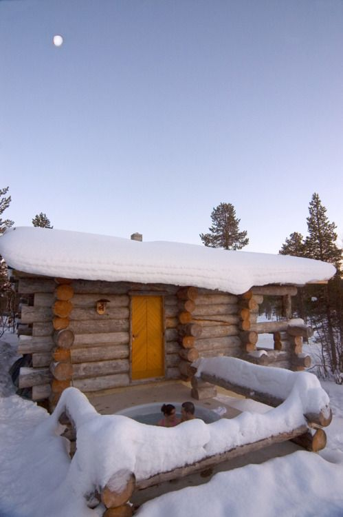 The cabin's addition of a hot tub would be great with this kind of winter.