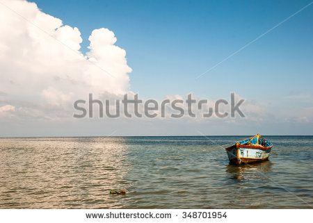 Lonely boat in the sea. Goa. India