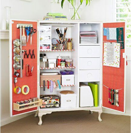 Looking for storage ideas? Turn an old armoire into a crafts storage center by retro-fitting it with shelves, hooks and little storage bins.