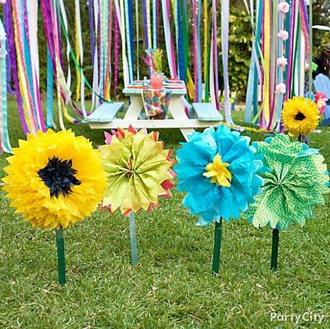 Grow a garden of DIY flowers made of bright tissue paper! Click for the how-to with step-by-step photos! Perf for an Easter party.