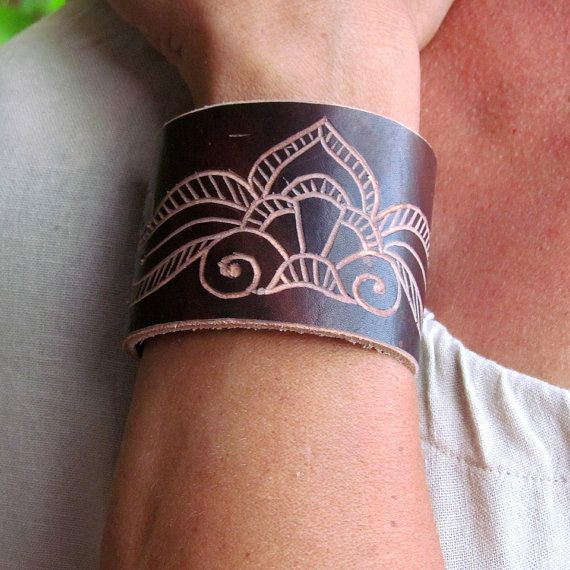 Carved leather bracelet with acantus design and brass by kutilajos, $32.00