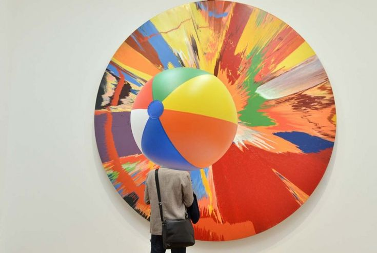 Visiting a Spin Painting by Damien Hirst. via baltimoresun. Photo by TobyMelville. #Damien_Hirst #Spin_Painting #Damien_Hirst