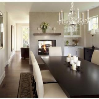 dark rug, light chairs, dark table, light center piece