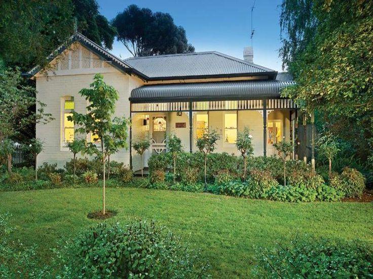 Brick victorian house exterior with return verandah.
