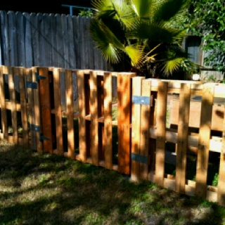 Pallet fence my hubby build for our side yard. Now I just need to stain it.