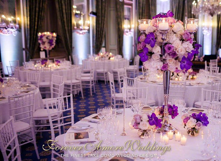 Elegant centerpiece with tall silver candelabra and important flower arrangement with roses, hydrangeas, lisianthus and wanda orchids in the shades of white, champagne, lilac and purple. Picture by Flavio Bandiera ©