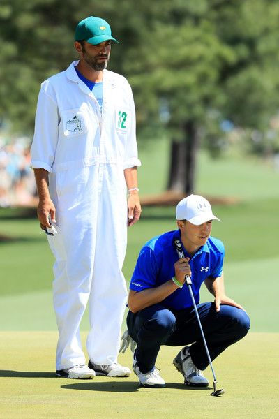 Jordan Spieth of the United States lines up a putt on the first hole as caddie Michael Greller looks on during the final round of the 2017 Masters Tournament at Augusta National Golf Club on April 9, 2017 in Augusta, Georgia.