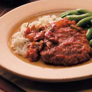 Taste of Home Easy Swiss Steak. 4 beef cubed steaks (4 ounces each)  1 tablespoon canola oil  1 medium onion, chopped  1 celery rib with leaves, chopped  1 garlic clove, minced  1 can (14-1/2 ounces) stewed tomatoes, cut up  1 can (8 ounces) tomato sauce  1 teaspoon beef bouillon granules  1 tablespoon cornstarch  2 tablespoons cold water, stovetop simmer for 1-1/2 to 2 hrs.