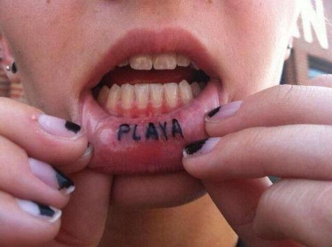 playa inside lip tattoo