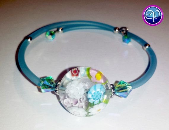 Memory wire bracelet with focal Millefiori bead and Swarovski accent beads.  https://www.etsy.com/listing/197371846/murano-bead-memory-wire-bracelet-with