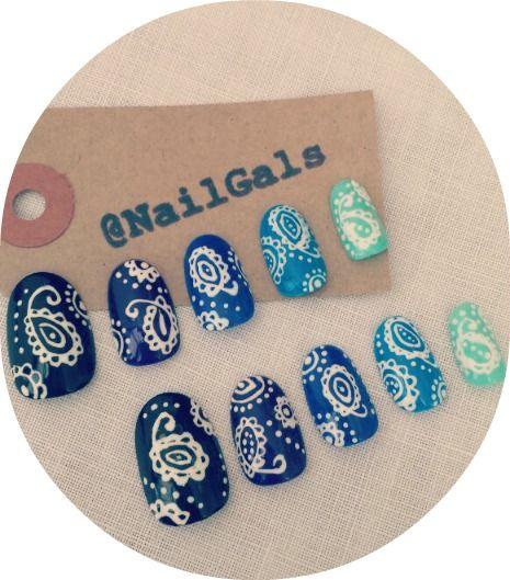 blue ombre nails with a pretty white paisley design on top #nailart #nails #design #cutenails #prettynails #falsenails #glueonnails #beauty #fashion #style #funkynails