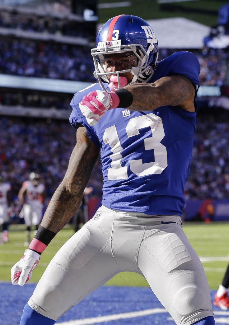 Beckham TD catch caps Giants rally vs. Falcons - New York Giants wide receiver Odell Beckham celebrates after scoring on a touchdown pass from quarterback Eli Manning during the second half of an NFL football game, Sunday, Oct. 5, 2014, in East Rutherford, N.J. (AP Photo/Seth Wenig)