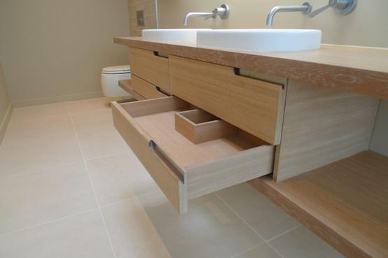 Custom made bathroom cabinet in limed oak with lighting