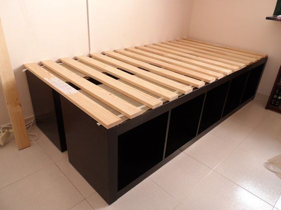 BRILLIANT! especially if you need storage but ALSO need to have a guest bed occasionally. just put the shelves ontop of eachother with the slat bed base behind it and bring out when you need it and top with a foam mattress that can be stored rolled up in a closet or under a bed.... INSTABED.    ikea expedit -----> twin bed:
