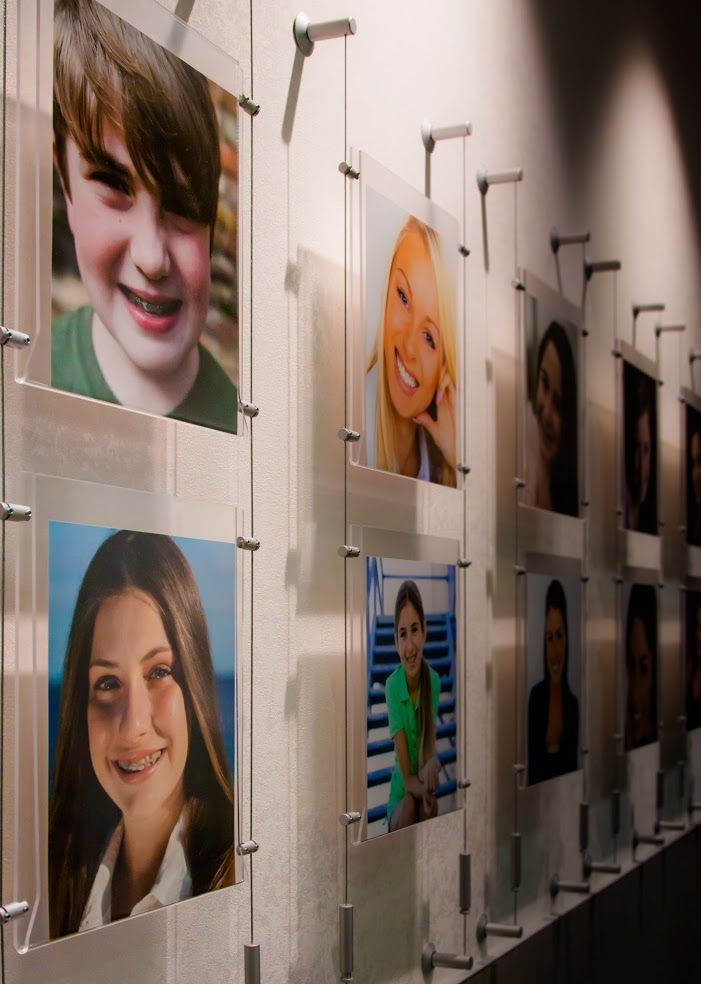 Smile Wall photos in orthodontic office.