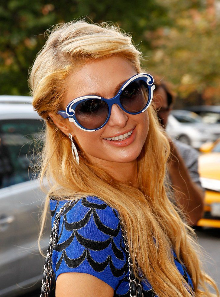 Pin for Later: See the Gorgeous Celebrities Sitting Front Row at Fashion Week Paris Hilton at Diane Von Furstenberg At the Diane Von Furstenberg show, Paris paired her California-girl beach waves with peach lipstick and bright blue sunglasses.