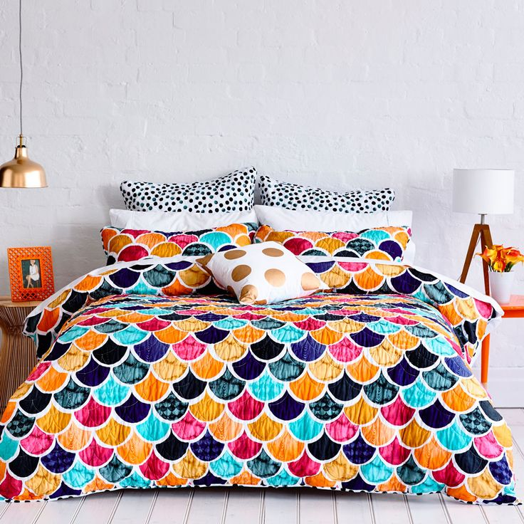A stunning quilted scalloped design, the Penelope quilt cover is a multi-colour burst of life and fun style. Soft, watercolour spot reverse is carried across to european pillowcases and completes a magnificent design from Mercer + Reid.