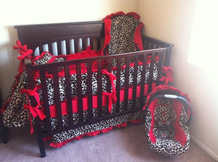 Cheetah print with bright red on edges of crib and car seat. Fashionable baby room♥