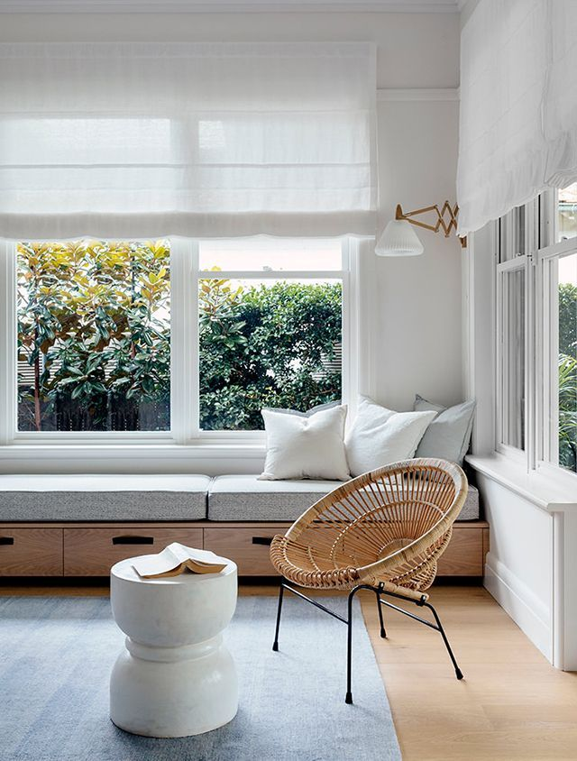 Wicker Chair And Upholstered Window Bench With Drawers Via Remodelistau2026