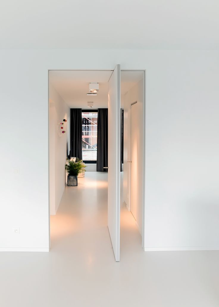 Modern pivot door with offset axis pivoting hinges. No built-in parts to either floor or ceiling!