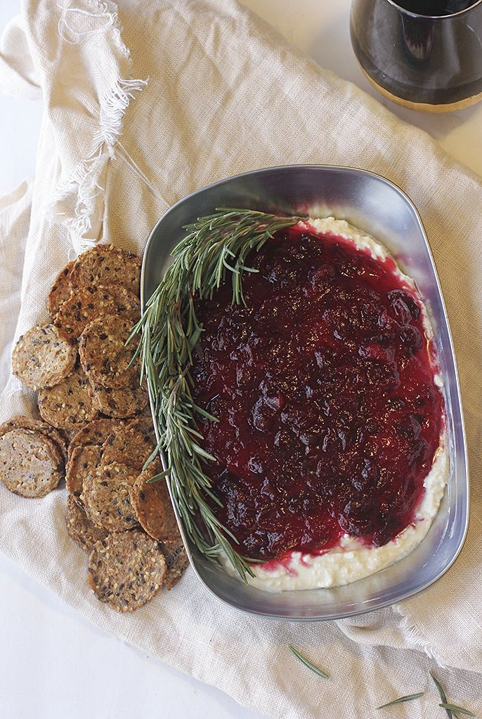 Homemade jalapeño and cranberry sauce over whipped feta. The perfect Christmas appetizer!