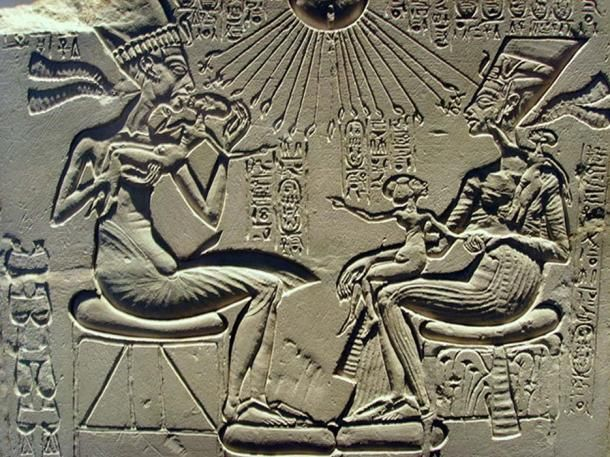 """A """"house altar"""" depicting Akhenaten, Nefertiti, and three of their daughters."""