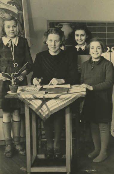Anne Frank with her teacher and two fellow pupils at the 6th Montessori School in Amsterdam.