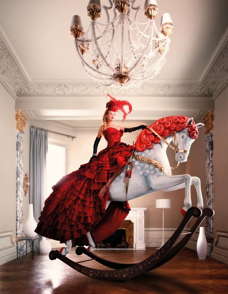 Dress is crazy fab, the horse... OMG we need one!
