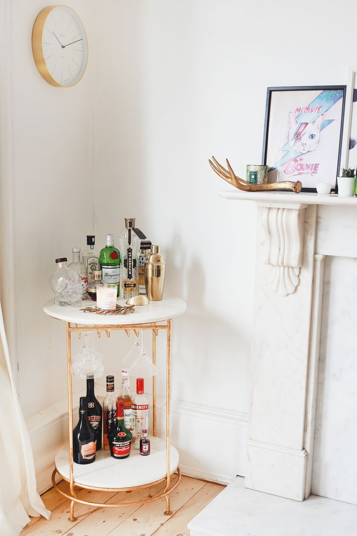 Ahh my bar cart! This is definitely one of my favourite pieces in my home; I had wanted a bar cart for so long before I picked up this little lovely. I had initially DIY'd a trolley I found on Gumtree, but it didn't work with our interiors in the end so I kept looking. Eventually I laid eyes on this absolute beauty – it was truly love at first sight! The marble and gold creation is from Oliver Bonas, I spotted it while browsing the site one night and bought it almost straight away! I…