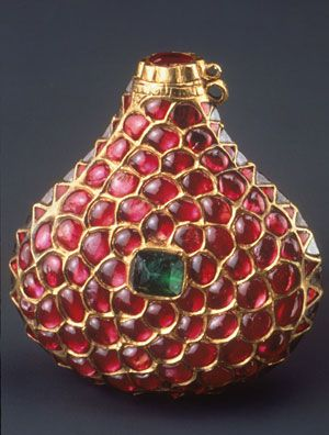 The Mughals adore perfumes and scented oils. The emperor Akbar (1542-1605) even established a perfumery department within his workshops which created concoctions using musk., ambergris, aloe wood and sandal paste to please the noses of the royal household. This miniature cosmetics bottle set with rubies emeralds and diamonds comes from North India, c1600-1633.