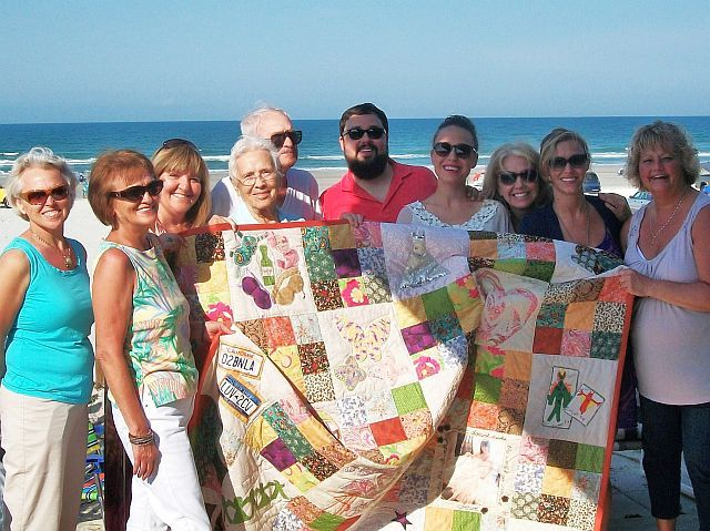 the quilters of the wedding quilt and the lucky young couple