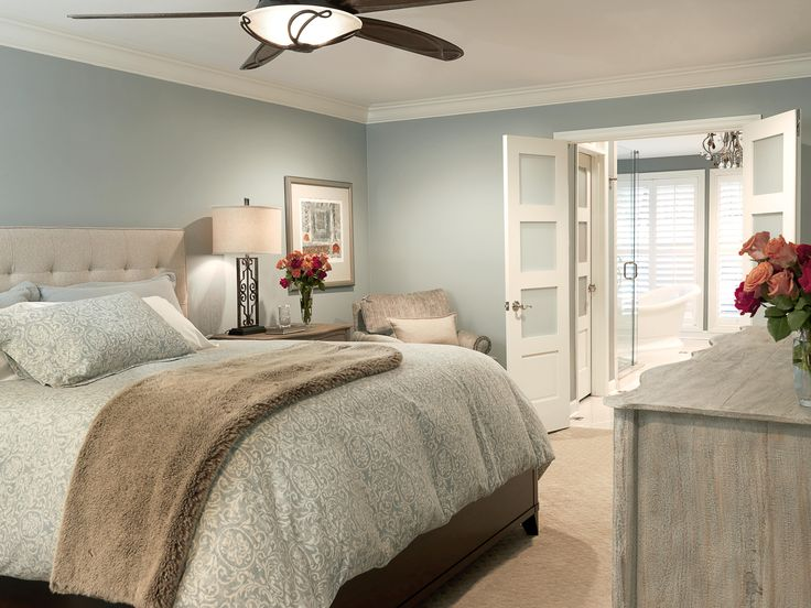 Designed by Directions in Design Inc. - St. Louis, MO - bedroom, light blue walls, bathroom off bedroom, french doors