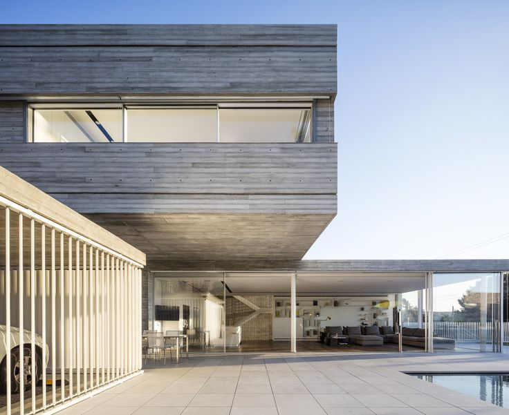 In a duplex house located in a small neighborhood north of Tel-Aviv, Israel, resides two families of close friends. Both are well attuned to modern architecture as they are owners of construction technology solutions businesses.